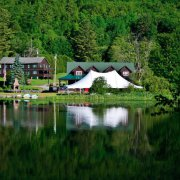 Photo of Twin Pines Resort from the lake surrounded by trees
